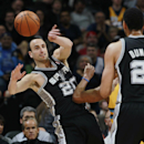 San Antonio Spurs guard Manu Ginobili (20), of Argentina, passes the ball around Denver Nuggets guard Randy Foye to Spurs center Tim Duncan in the first quarter of an NBA basketball game in Denver, Friday, March 28, 2014 The Associated Press