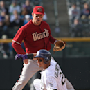 Arizona Diamondbacks second baseman Aaron Hill, back, forces out Colorado Rockies' Troy Tulowitzki at second base on the front end of a double play hit into by Wilin Rosario in the ninth inning of the Diamondbacks' 5-3 victory in a baseball game in Denver