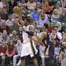 Utah Jazz's Derrick Favors (15) catches a pass as New Orleans Pelicans' Anthony Davis (23) defends in the second quarter during an NBA basketball game Friday, April 4, 2014, in Salt Lake City. The Jazz won 100-96 The Associated Press