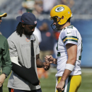 Green Bay Packers quarterback Aaron Rodgers, right, talks to injured Chicago Bears cornerback Charles Tillman before an NFL football game Sunday, Sept. 28, 2014, in Chicago. The Associated Press