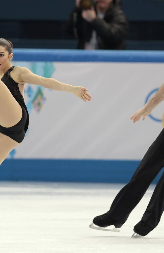Marissa Castelli and Simon Shnapir of the United States compete in the team pairs short program figure skating competition at the Iceberg Skating Palace during the 2014 Winter Olympics, Thursday, Feb. 6, 2014, in Sochi, Russia