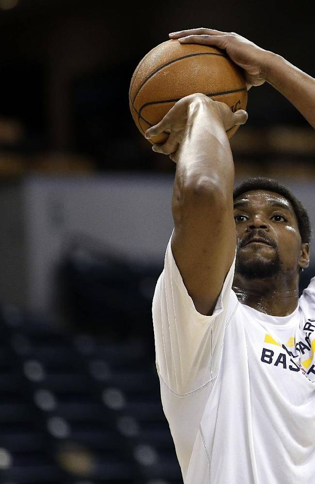 Indiana Pacers center Andrew Bynum warms up before the Pacers played the Boston Celtics in an NBA basketball game in Indianapolis, Tuesday, March 11, 2014. Bynum is expected to make his debut with the Pacers in the game, marking his first NBA game in nearly three months