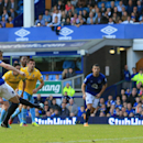 Everton's Leighton Baines, left, scores his side's second goal of the game during their English Premier League soccer match against Crystal Palace at Goodison Park, Liverpool, England, Sunday, Sept. 21, 2014