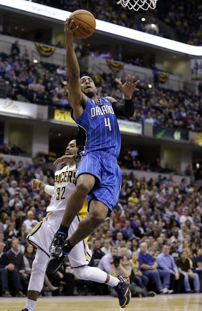 Orlando Magic guard Arron Afflalo gets a bucket on a fast break in front of Indiana Pacers guard George Hill in the first half of an NBA basketball game in Indianapolis, Monday, Feb. 3, 2014