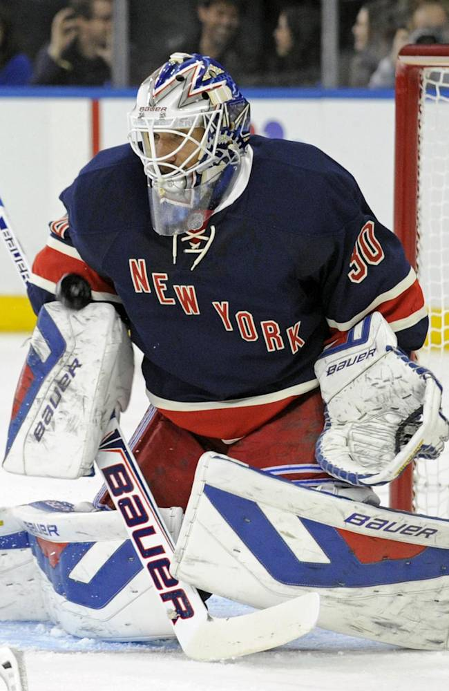 New York Rangers goaltender Henrik Lundquist, of Sweden, makes a save during the first period of an NHL hockey game against the Carolina Hurricanes on Saturday, Nov. 2, 2013, at Madison Square Garden in New York