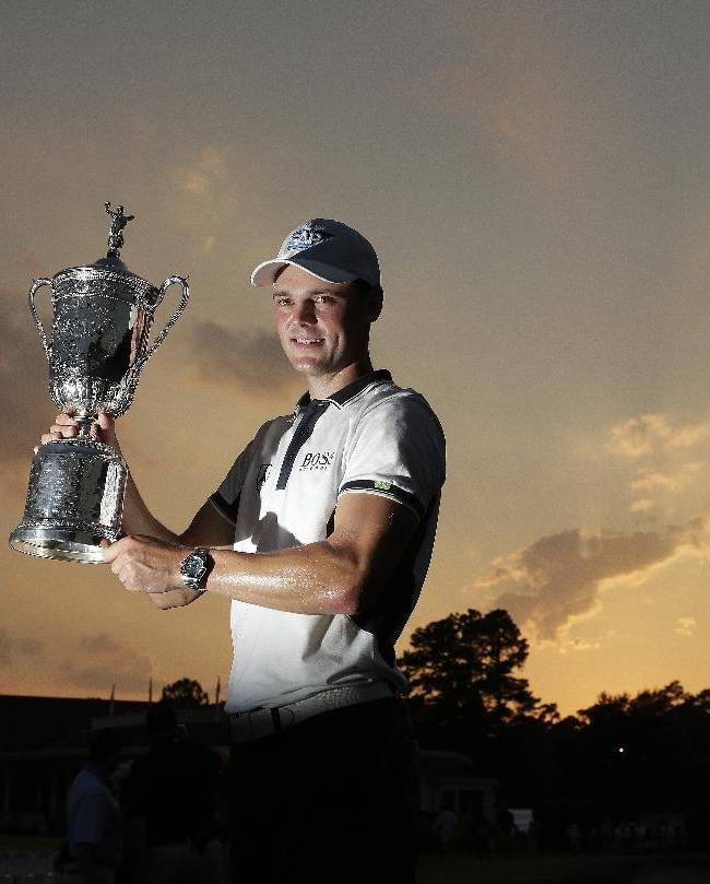 Martin Kaymer, of Germany, poses with the trophy after wining the U.S. Open golf tournament in Pinehurst, N.C., Sunday, June 15, 2014