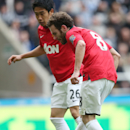 Manchester United's Juan Mata, right, scores during their English Premier League soccer match against Newcastle United at St James' Park, Newcastle, England, Saturday, April 5, 2014