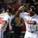 Atlanta Braves' Justin Upton, right, high-fives teammate Dan Uggla after hitting a home run in the eighth inning of a baseball game against the Washington Nationals, Friday, April 11, 2014, in Atlanta The Associated Press