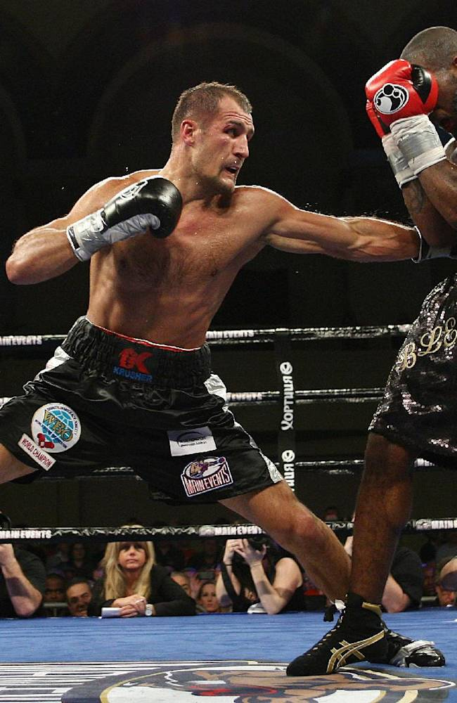Sergey Kovalev, left, of Russia, punches Cedric Agnew, of the United States, during the sixth round of WBO light heavyweight boxing title in Atlantic City, N.J., on Saturday, March 29, 2014. Kovalev won by knockout in the seventh round