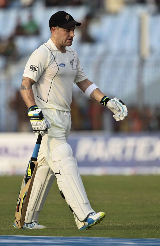 New Zealand's captain Brendon McCullum walks off the pitch after his dismissal by Bangladesh's Abdur Razzak on the first day of their first test cricket match in Chittagong, Bangladesh, Wednesday, Oct. 9, 2013