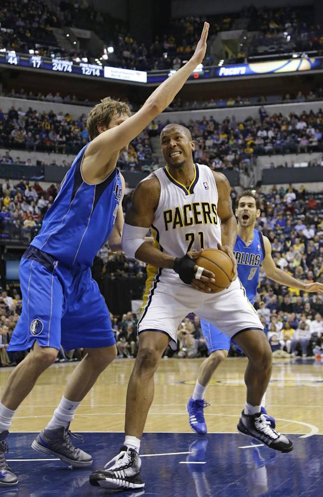 Indiana Pacers forward David West, right, is stopped by Dallas Mavericks forward Dirk Nowitzki during the second half of an NBA basketball game in Indianapolis, Wednesday, Feb. 12, 2014. The Mavericks defeated the Pacers 81-73