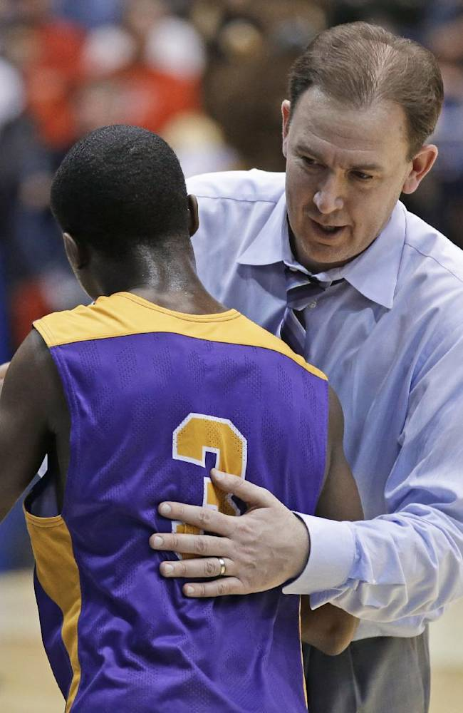 Albany coach Will Brown hugs guard DJ Evans (3) after Albany defeated Mount St. Mary's 71-64 in a first-round game of the NCAA college basketball tournament, Tuesday, March 18, 2014, in Dayton, Ohio