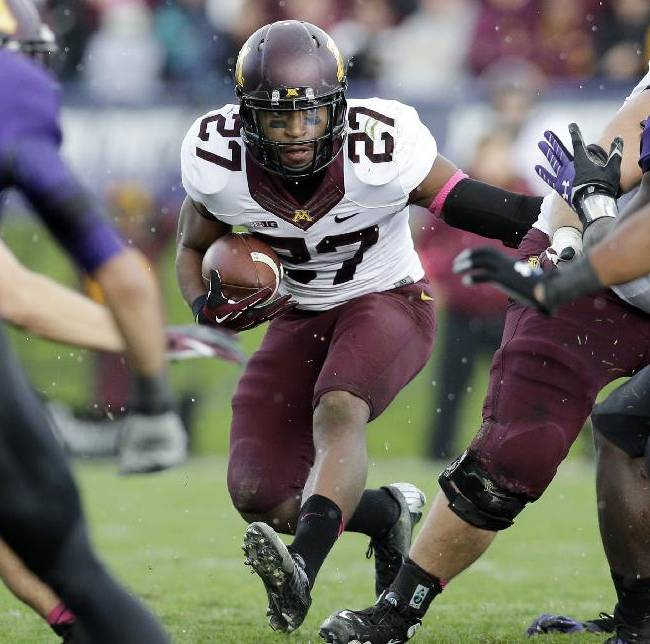 Minnesota running back David Cobb (27) runs with the ball during the second half of an NCAA college football game against Northwestern in Evanston, Ill., Saturday, Oct. 19, 2013. Minnesota won 20-17