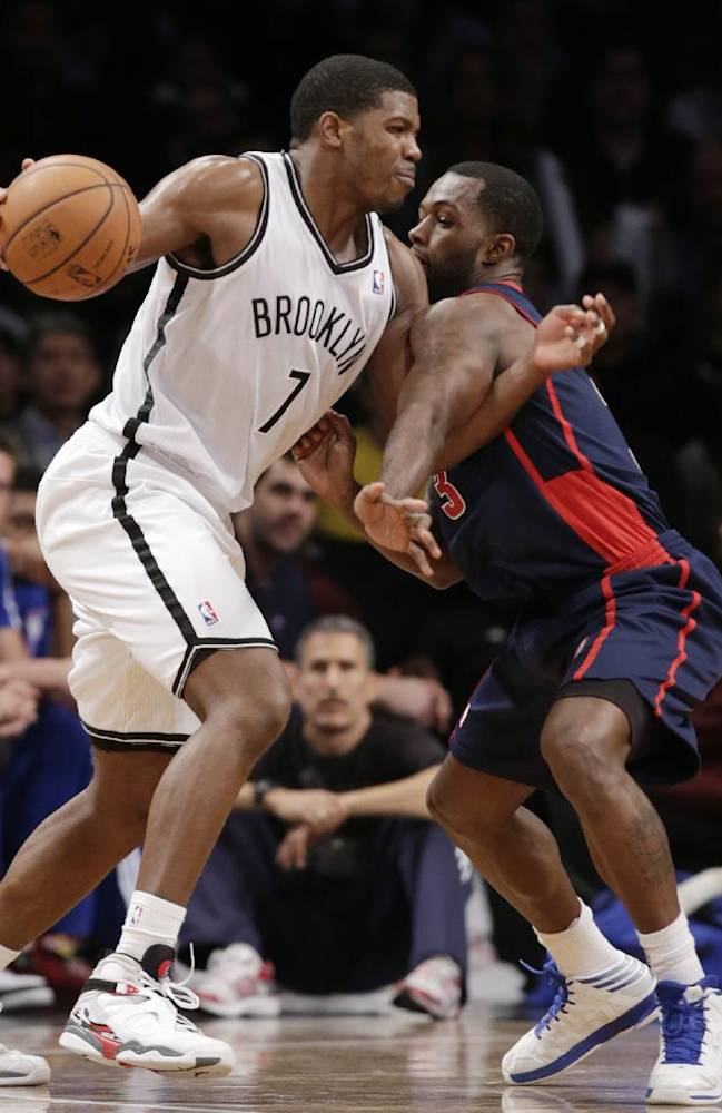Detroit Pistons guard Rodney Stuckey, right, defends Brooklyn Nets guard Joe Johnson (7) in the second half of an NBA basketball game, Sunday, Nov. 24, 2013, in New York. The Pistons won 109-97