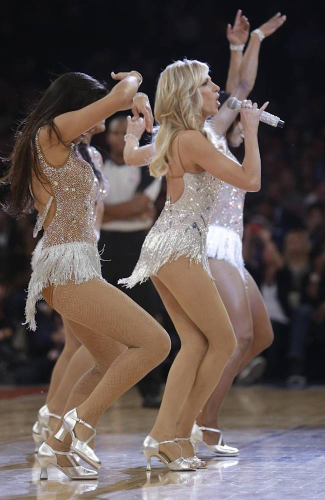 Debbie Gibson performs during the first half of an NBA basketball game between the New York Knicks and the Houston Rockets Thursday, Nov. 14, 2013, in New York