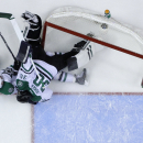Dallas Stars' Sergei Gonchar, left, of Russia, collides with goalie Tim Thomas during the second period of an NHL hockey game against the Philadelphia Flyers, Thursday, March 20, 2014, in Philadelphia The Associated Press