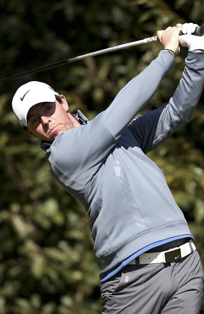 Rory McIlroy of Northern Ireland watches his shot on the second hole during the second round of the Korea Open golf tournament at Woo Jeong Hills Country Club in Cheonan, South Korea, Friday, Oct. 18, 2013