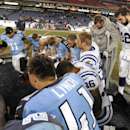 Indianapolis Colts quarterback Andrew Luck (12) stands with injured Tennessee Titans quarterback Jake Locker as players pray after an NFL football game Thursday, Nov. 14, 2013, in Nashville, Tenn. The Colts won 30-27 The Associated Press