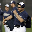 San Diego Padres' Carlos Quentin walks onto the practice field for a morning work out during spring training baseball practice, Friday, Feb. 21, 2014, in Peoria, Ariz The Associated Press