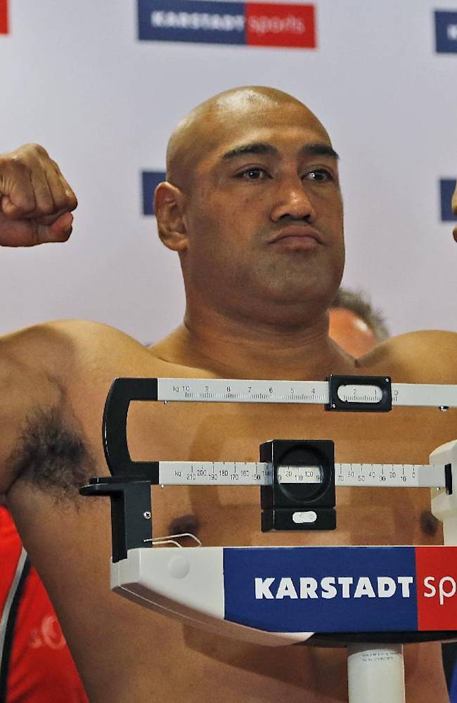 Boxing challenger Alex Leapai from Australia-Samoa, poses during the weighing procedure ahead of his IBF, IBO, WBO and WBA heavyweight title bout against challenger, world boxing champion Wladimir Klitschko of Ukraine, in Muelheim, Germany, Friday, April 25, 2014