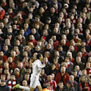 Real Madrid's Cristiano Ronaldo celebrates after scoring the opening goal during the Champions League group B soccer match between Liverpool and Real Madrid at Anfield Stadium, Liverpool, England, Wednesday Oct. 22, 2014
