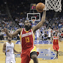Houston Rockets' James Harden (13) makes a shot as he gets out in front of E'Twaun Moore (55) during the second half of an NBA basketball game in Orlando, Fla., Wednesday, March 5, 2014. Houston won 101-89 The Associated Press