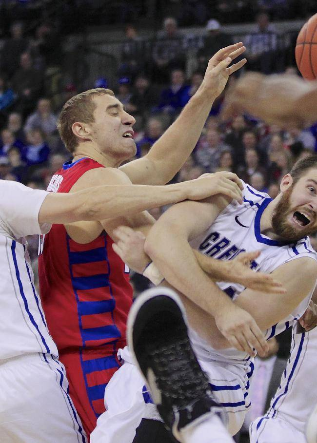 Creighton's Grant Gibbs (10), DePaul's Sandi Marcius, second from left, and Creighton's Ethan Wragge, second from right, and Austin Chatman go for a rebound during the second half of an NCAA college basketball game in Omaha, Neb., Friday, Feb. 7, 2014. Creighton won 78-66