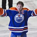 Edmonton Oilers' Ryan Smyth waves to the crowd after playing his last NHL hockey game, Saturday April 12, 2014, against the Vancouver Canucks in Edmonton, Alberta. The Oilers won 5-2 The Associated Press