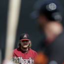 Arizona Diamondbacks starting pitcher Wade Miley looks on before delivering against San Francisco Giants' Brandon Belt during the first inning of a spring training baseball game on Sunday, March 2, 2014, in Scottsdale, Ariz The Associated Press