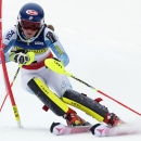 Mikaela Shiffrin, of Vail, Colo., hits a gate during her first run of the women's slalom skiing race at the US Alpine Ski Championship in Carrabassett Valley, Maine, Saturday, March 28, 2015. Shiffrin won the event. (AP Photo/Charles Krupa)