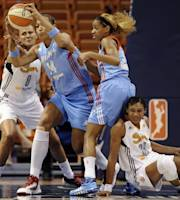 Connecticut Sun's Mistie Bass, left, and Atlanta Dream's Erika de Souza, second from left, battle for a rebound as Dream's Jasmine Thomas, second from right, and Sun's Iziane Castro Marques, right, defend, during the first half of a WNBA basketball game in Uncasville, Conn., Wednesday, Sept. 11, 2013. (AP Photo/Jessica Hill)