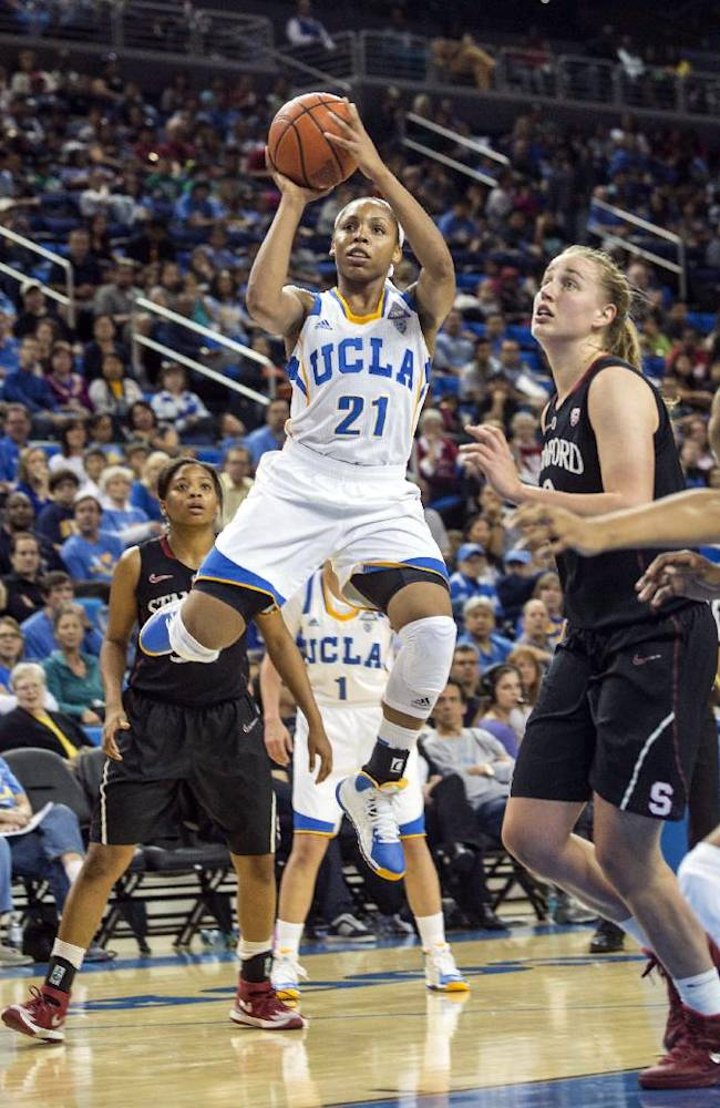 UCLA guard Nirra Fields, left, drives to the basket and shoots the ball while defended by Stanford forward Mikaela Ruef, right, in the second half of an NCAA women's college basketball game, Sunday, Feb. 23, 2014 in Los Angeles. Stanford won 65-54. Fields scored a team-high 24 points