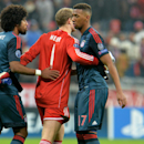 Bayern's Dante, goalkeeper Manuel Neuer and Jerome Boateng, from left, leave the pitch after the Champions League group D soccer match between FC Bayern Munich and Manchester City, in Munich, southern Germany, Tuesday, Dec. 10, 2013. Manchester defeated M