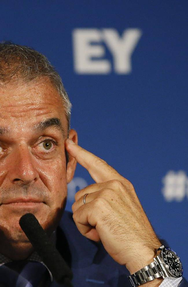 European Ryder cup team captain Paul McGinley touches his face as he listens during a press conference at Wentworth Golf Club to announce his three wild card selections for his team to play at Gleneagles in Scotland against the USA, in Wentworth England, Tuesday, Sept. 2, 2014