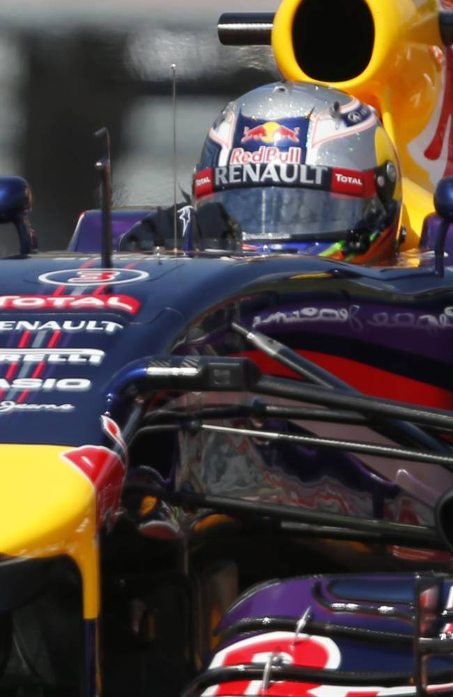 Red Bull driver Daniel Ricciardo of Australia steers his car during the free practice at the Hungarian Formula One Grand Prix in Budapest, Hungary, Friday, July 25, 2014. The Hungarian Grand Prix will be held on Sunday, July 27, 2014