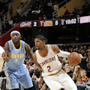 CLEVELAND, OH - DECEMBER 4: Kyrie Irving #2 of the Cleveland Cavaliers drives to the basket against Ty Lawson #3 of the Denver Nuggets at The Quicken Loans Arena on December 4, 2013 in Cleveland, Ohio. (Photo by David Liam Kyle/NBAE via Getty Images)