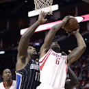 Houston Rockets power forward Terrence Jones (6) drives to the basket past Orlando Magic power forward Glen Davis (11) during the second half of an NBA basketball game Sunday, Dec. 8, 2013, in Houston The Associated Press