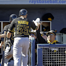 Pittsburgh Pirates Russell Martin is greeted at the dugout after hitting a three-run homer off Tampa Bay Rays relief pitcher Grant Balfour in the fourth inning of a exhibition baseball game in Port Charlotte, Fla., Saturday, March 8, 2014 The Associated