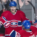 Montreal Canadiens' Max Pacioretty (67) celebrates with teammate Thomas Vanek after scoring against the Detroit Red Wings during the second period of an NHL hockey game in Montreal, Saturday, April 5, 2014 The Associated Press