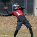 Carolina Panthers quarterback Cam Newton prepares to throw a pass during an NFL football practice in Charlotte, N.C., Wednesday, Dec. 17, 2014. (AP Photo/Chuck Burton)