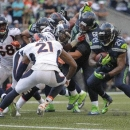 Seattle Seahawks running back Marshawn Lynch (24) runs before he dove in for the game-winning touchdown in overtime of an NFL football game against the Denver Broncos, Sunday, Sept. 21, 2014, in Seattle. The Seahawks won 26-20 The Associated Press