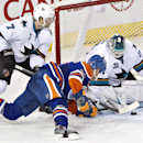 San Jose Sharks goalie Antti Niemi (31) makes the save on Edmonton Oilers Matt Hendricks (23) as Brad Stuart (7) defends during third period NHL hockey action in Edmonton, Alta., on Tuesday March 25, 2014 The Associated Press