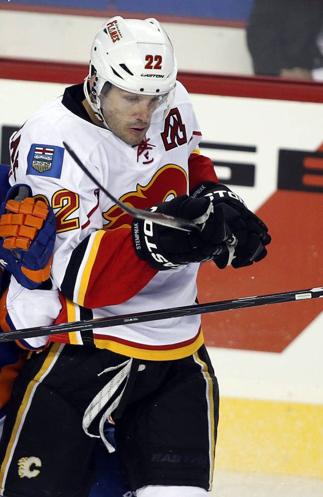 New York Islanders' Michael Grabner, left, of Austria, collides with Calgary Flames' Lee Stempniak during the second period of a split-squad preseason NHL hockey game against the New York Islanders in Calgary, Alberta, Tuesday, Sept. 17, 2013