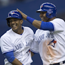 Toronto Blue Jays' Ricardo Nanita, left, is congratulated by teammate Edwin Encarnacion after hitting a single scoring Munenori Kawasaki to beat the New York Mets 5-4 in the ninth inning Friday, March 28, 2014 in Montreal The Associated Press