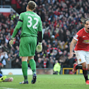 Manchester United's Radamel Falcao, right, celebrates scoring his team's second goal against Leicester City, during their English Premier League soccer match at Old Trafford, Manchester, England, Saturday, Jan. 31, 2015