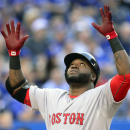 Boston Red Sox's David Ortiz celebrates his three run home run against the Toronto Blue Jays during the first inning of a baseball game, Thursday, July 2, 2015, 2015 in Toronto. (Frank Gunn/The Canadian Press via AP) MANDATORY CREDIT