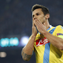 Napoli midfielder Christian Maggio touches his face after missing a scoring chance during a Champions League, group F soccer match against Arsenal, at the Naples San Paolo stadium, Italy, Wednesday, Dec. 11, 2013