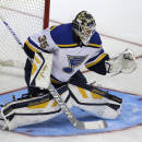 CORRECTS SCORE TO 4-3-St. Louis Blues goalie Niklas Lundstrom (35) tries to stop a shot on goal during the third period of an NHL preseason hockey game against the Dallas Stars, Monday, Sept. 22, 2014, in Dallas. The Stars won 4-3. (AP Photo/LM Otero)