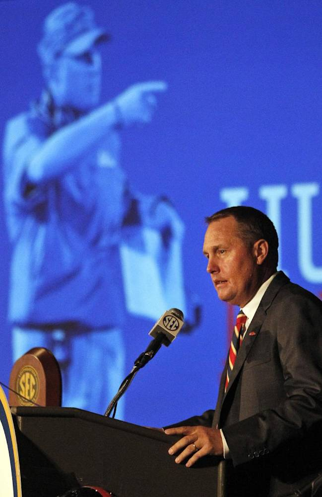 Mississippi coach Hugh Freeze speaks to the media at the Southeastern Conference NCAA college football media days, Thursday, July 17, 2014, in Hoover, Ala