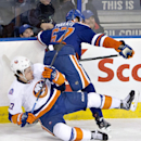 New York Islanders Anders Lee, left, is checked by Edmonton Oilers Benoit Pouliot, right, during third period NHL hockey action in Edmonton, Alta., on Sunday, Jan. 4, 2015 The Associated Press